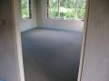 Afgewerkte betonvloer.