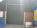 Nieuwe sektionaal deur geplaatst incl. damwand.